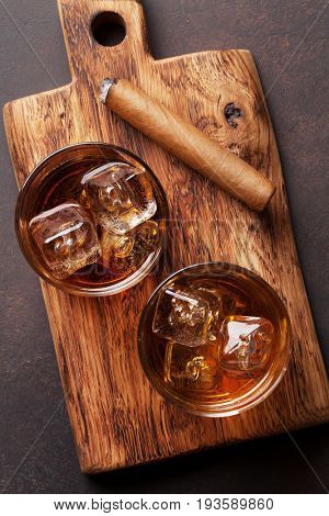 Whiskey with ice and cigar. Top view