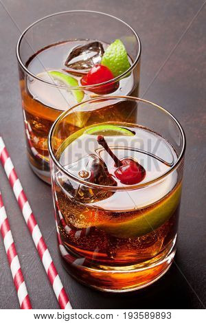 Cuba libre cocktail glasses on stone table