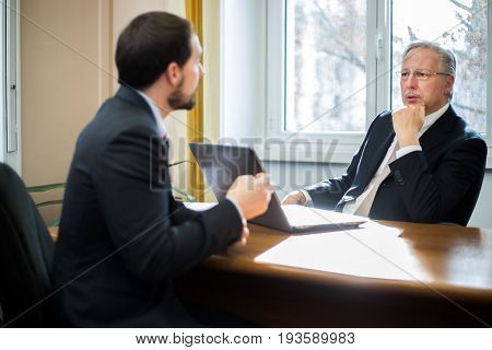 Businessman interviewing a candidate in an office