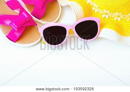 Large beach hat and glasses from the sun, flipflops