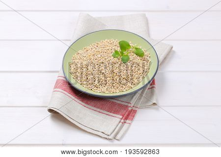 plate of pearl barley on folded place mat