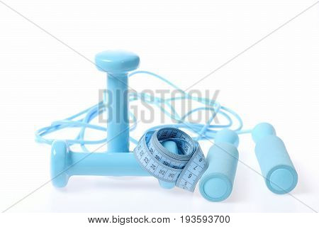 Roll Of Blue Flexible Ruler Lying On Barbells, Skipping Rope