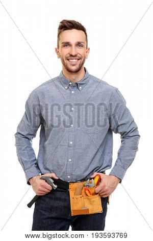 Young carpenter with tool-belt on white background