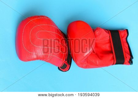 Pair Of Leather Boxing Sportswear. Sport Equipment Isolated On Blue