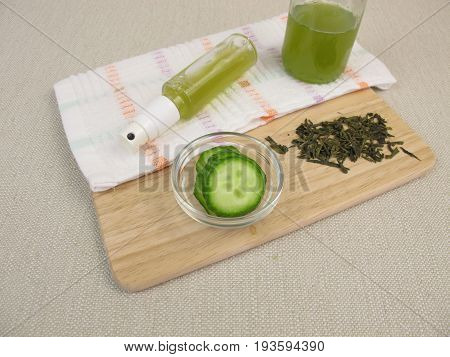 Homemade facial spray with green tea and cucumber against impure and dry skin