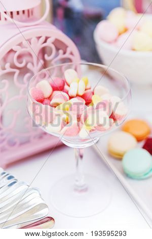 Candy bar on wedding ceremony. Decorated table with sweets for the guests of the ceremony.
