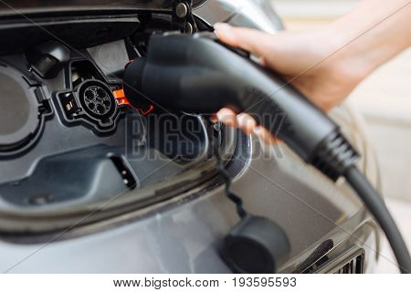 Eco-friendly car. The focus being on the charging system of a car, namely on the inlet being ready to be charged by an electric nozzle