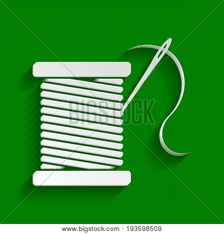 Thread with needle sign illustration. Vector. Paper whitish icon with soft shadow on green background.