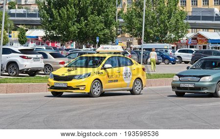 VOLGOGRAD - JUNE 8: New yellow car with advertising on the back belonging to the service