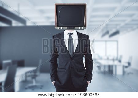 Obsolete TV headed businessman in blurry interior. Abstraction concept. Mock up 3D Rendering