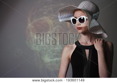 Young Beautiful Fashionable Woman With Trendy Makeup. Model Looking At Camera, Wearing Stylish Eyegl