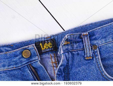Chisinau Moldova February 17 2017: Close up of the Lee button on the blue jeans. Lee brand denim jeans.It is an American manufacturer founded in 1889.