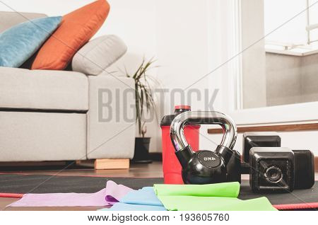 Fitness exercise equipment. Woman fitness exercise equipment at the home floor. In home sport concept. Training.