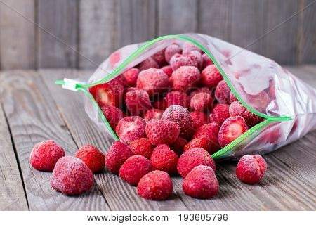 Frozen strawberries in a bag on the table
