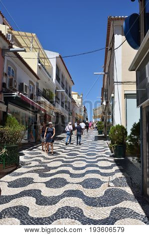 CASCAIS PORTUGAL - JUNE 7 2017: Street with in Cascais. Cascais is famous and popular summer vacation spot for Portuguese and foreign tourists