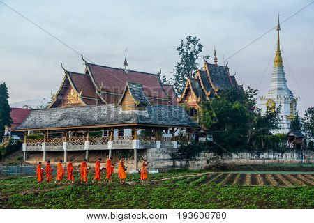 CHIANGMAI THAILAND - JANUARY 25 2015: Buddhist monks getting back temple after seeking alms. This is usual every day duty of Buddhist monks.