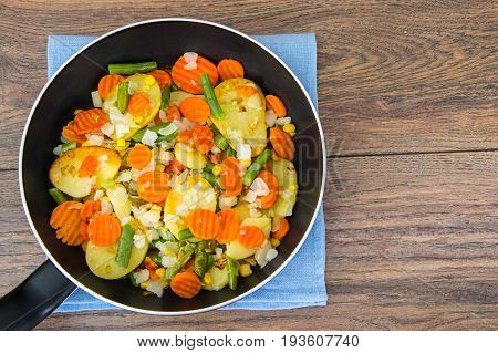 Food without meat:fried vegetables in frying pan. Studio Photo