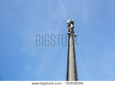 Communication Tower with antennas such a Mobile phone tower, Cellphone Tower, Phone Pole on the blue sky background.