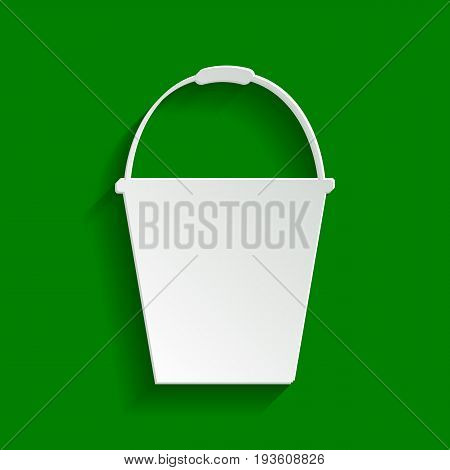 Bucket sign for garden. Vector. Paper whitish icon with soft shadow on green background.