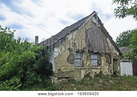An old abandoned and devastated farmhouse that is prone to decline.