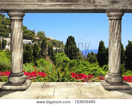 Frame with two medieval columns and top view on landscape with flower and  Mediterranean sea on Capri island, Italy, Europe. 3d render