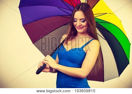 Woman In Summer Dress Holds Colorful Umbrella