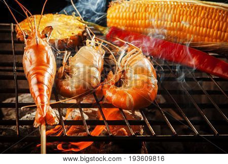 prawn shrimp grilled on barbe-que fire stove with pineapple red chilly and corn