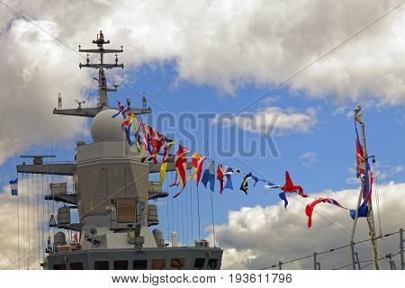 Details deck of the ship. The mast of the ship and signal flags