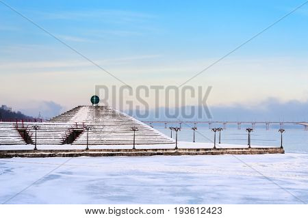 Snowy Embankment Along The Misty River With Lanterns At The Foggy Morning - Winter Landscape. Vi