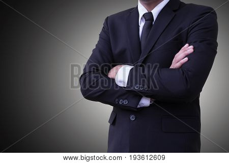 Business personality  standing arms crossed  Wear a suit On a gray background or backdrop