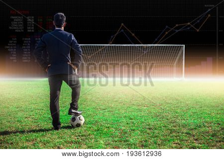Businessman With Football In The Stadium Foolball.