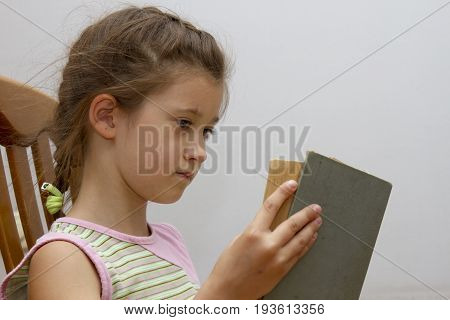 Little Girl Reading Big Book