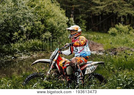 Kyshtym Russia - June 18 2017: motocross enduro athlete on motorcycle in forest trail during Ural Cup in Enduro