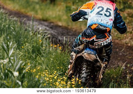 Kyshtym Russia - June 18 2017: back athlete bike enduro rides in forest track during Ural Cup in Enduro