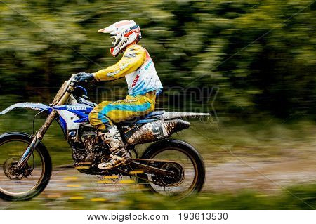 Kyshtym Russia - June 18 2017: blurred motion motorcyclist enduro during Ural Cup in Enduro