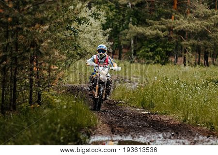 Kyshtym Russia - June 18 2017: athlete bike enduro rides in forest trail during Ural Cup in Enduro
