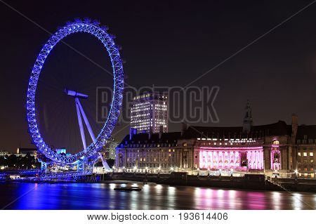 London, UK, September 13, 2011 : Thames cityscape at night showing the London Eye and  County Hall