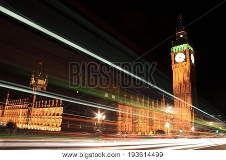 London, UK, September 13, 2011 : The Houses of Parliament at night with light trails from passing vehicles