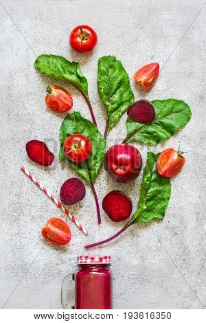 Detox drink Of beets tomatoes and apples. Red smoothies And ingredients detox concept. Top view with copy space