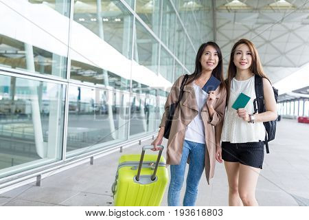 Women go travel and holding passport together