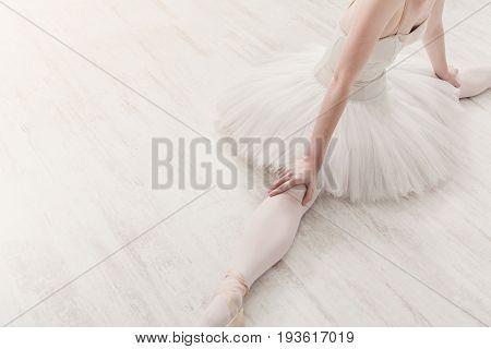 Ballerina top view portrait. Beautiful graceful ballet dancer in tutu skirt practice split ballet position, crop