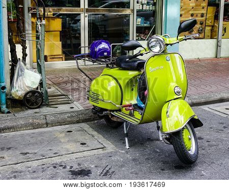 Scooter Parked At An Urban Street In Old Townhouse