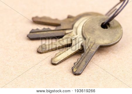 Old Brass Keys With Key Chain On Brown Background
