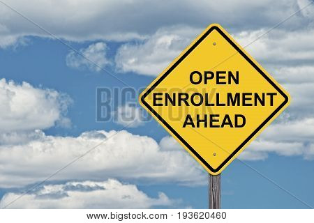 Caution Sign Blue Sky Background - Open Enrollment Ahead