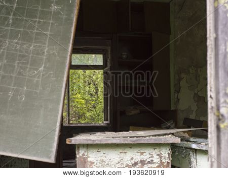 Ruins of Abandoned School Classroom in Ghost Town of Pripyat within Chernobyl Exclusion Zone