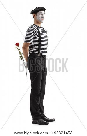 Full length profile shot of a mime with a rose waiting in line isolated on white background