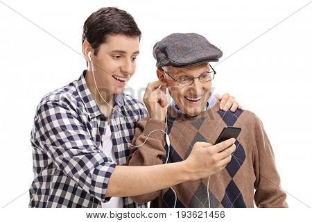 Grandson listening to music on a phone with his grandfather isolated on white background