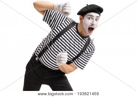 Mime behind an imaginary panel isolated on white background
