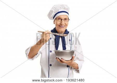 Chef holding a pot and a spoon isolated on white background