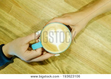 Human Feelings. Frothy Cappuccino Between Two Hands. Friendship Pastime